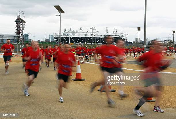 Competitors run around the Olympic Park during the National Lottery Olympic Park Run at Olympic Stadium on March 31, 2012 in London, England.
