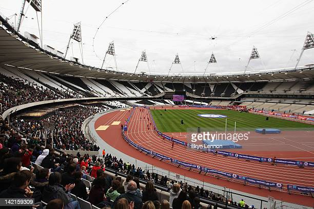 Competitors run around the Olympic Stadium during the National Lottery Olympic Park Run at Olympic Stadium on March 31, 2012 in London, England.