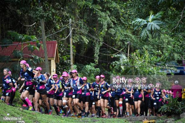 TOPSHOT Competitors run as they take part in the trail race of the Raid des Alizes an exclusively allfemale multi sport competition on the French...