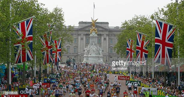 Competitors run down The Mall during the Flora London Marathon 2007 on April 22 2007 in London England