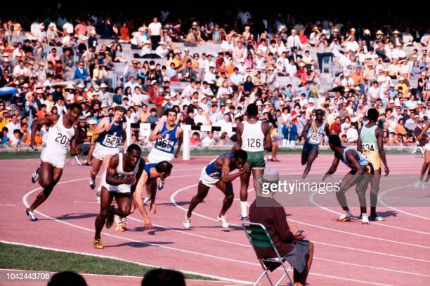 Competitors run during the final of the men's 4x100m relay on October 20 1968 in Mexico during the Mexico 1968 Olympic Games 6th L is French Roger...