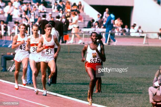 Competitors run during the men's 1500m final on October 20 during the Mexico 1968 Olympic Games From R to L Kenyan gold medal winner Kip Keino West...