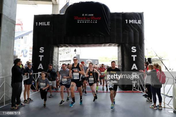 Competitors run during the St Jude Rock 'n' Roll Nashville Marathon 1 Mile run at Nissan Stadium on April 28 2019 in Nashville Tennessee