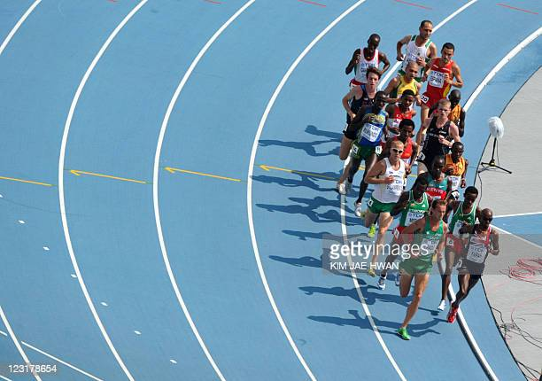 Competitors run in the men's 5000 metres heats at the International Association of Athletics Federations World Championships in Daegu on September 1...