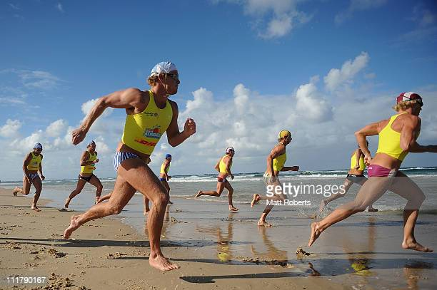 Competitors run into the water at the start of the Open Men's Ironman during the 2011 Australian Surf Lifesaving Championships at Kurrawa Beach on...