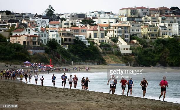 Competitors run on the beach during the Escape from Alcatraz Triathlon on June 4 2006 in San Francisco California