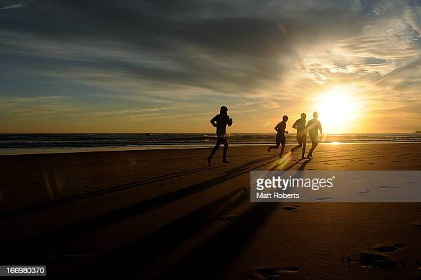 Competitors run on the beach prior to the start of day three of the 2013 Australian National Surf Lifesaving Titles on April 19 2013 on the Gold...