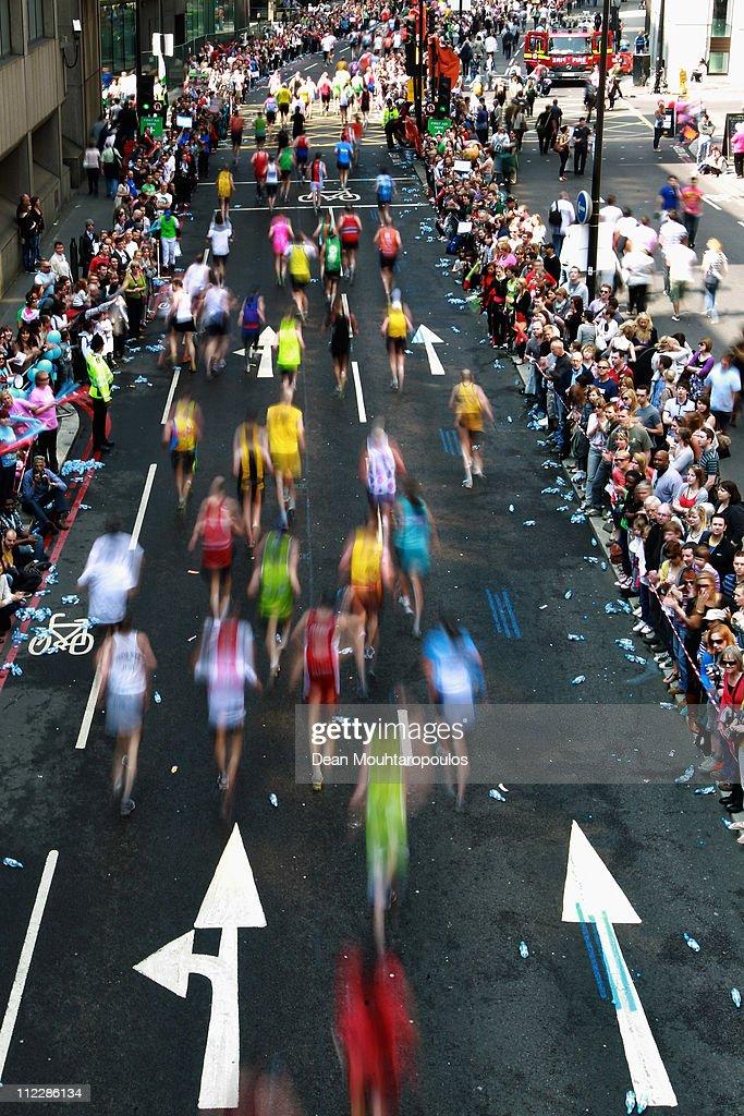 Competitors run past St Magnus the Martyr, London Bridge during the Virgin London Marathon 2011 on April 17, 2011 in London, England.