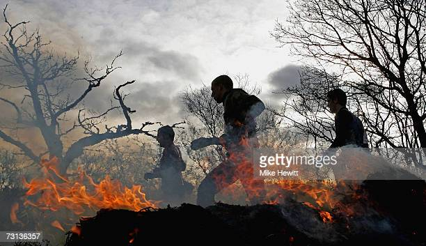 Competitors run through fire during the Tough Guy Challenge on January 28 2007 near Wolverhampton England