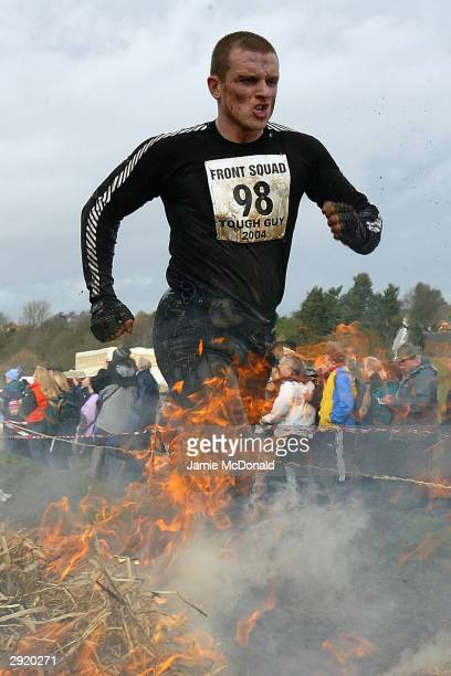 Competitors run through the flames of the Fiery Holes during the Tough Guy Challenge on February 1, 2004 in Wolverhampton, England.