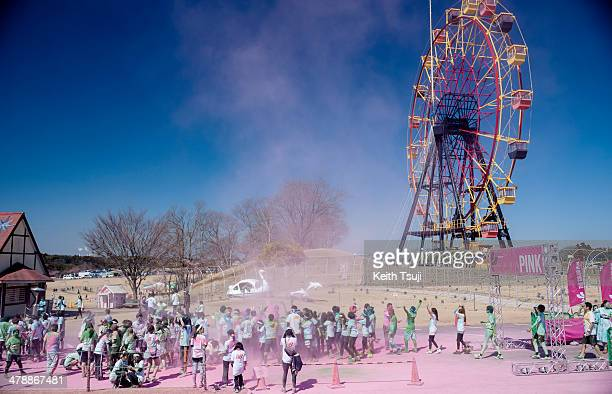 Competitors run through the pink color area during the Color Run Japan Tokyo 2014 at Doitsu Mura on March 15 2014 in Sodegaura Japan