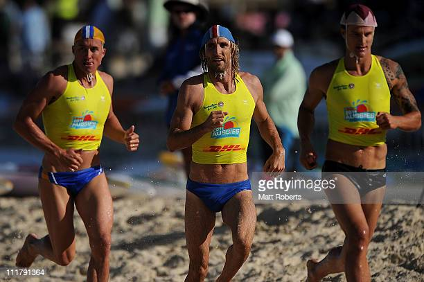 Competitors run to their boards in the Open Men's Ironman during the 2011 Australian Surf Lifesaving Championships at Kurrawa Beach on April 7 2011...