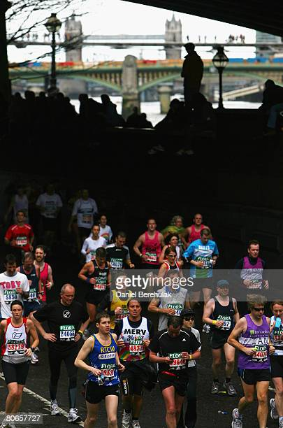 Competitors run under Blackfriars bridge during the 2008 Flora London Marathon on April 13 2008 in London England
