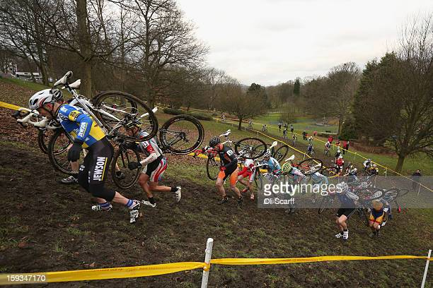 Competitors run up a hill as they take part in the 'Veteran 4049 Men' category race at the 2013 National CycloCross Championships in Peel Park on...