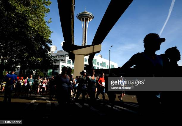 Competitors run with the monorail and Space Needle in the background during the 2019 Rock'n'Roll Seattle Marathon and 1/2 Marathon on June 9 2019 in...