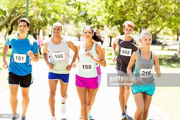 Competitors Running Marathon At Park