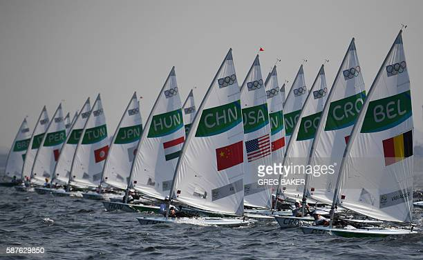 TOPSHOT Competitors sail during the Laser Women sailing class on Marina da Gloria in Rio de Janerio during the Rio 2016 Olympic Games on August 9...