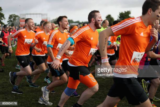 Competitors set of from the start line during the 2017 Tough Mudder South West at Badminton Estate on August 20 2017 in Cirencester England