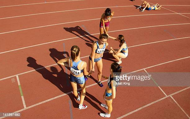 Competitors shake hands after competing in the Womens U18 400m Preliminaries during day three of the Australian Junior Athletics Championships at...
