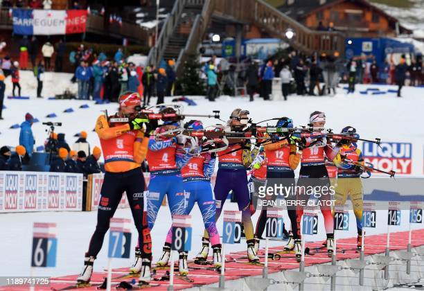 Competitors shoot during the women's pursuit during the IBU World Cup Biathlon in Le Grand Bornand on December 21 2019