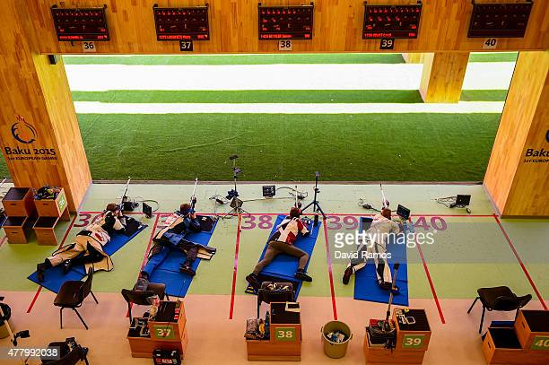 Competitors shoot in the Men's Rifle Shooting 3 positions Qualification Round during day nine of the Baku 2015 European Games at the Baku Shooting...