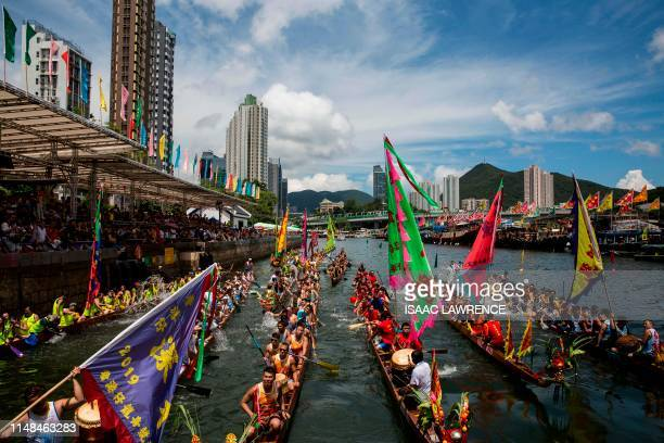 Competitors splash each other with water in a traditional ritual as they take part in the annual dragon boat race held to celebrate the Tuen Ng...
