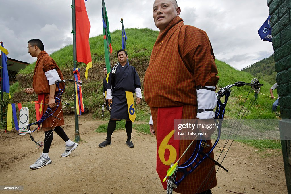 Competitors stand by during the17th Yangphel Open Archery Tournament Final in Thimphu, Bhutan on August 31, 2013. Archery, which became the national sport in Bhutan in 1971, is one of the most popular sports among soccer and volleyball.