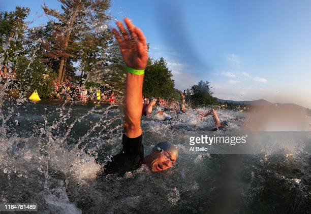 Competitors start during the Ironman triathlon on July 28 2019 in Lake Placid New York