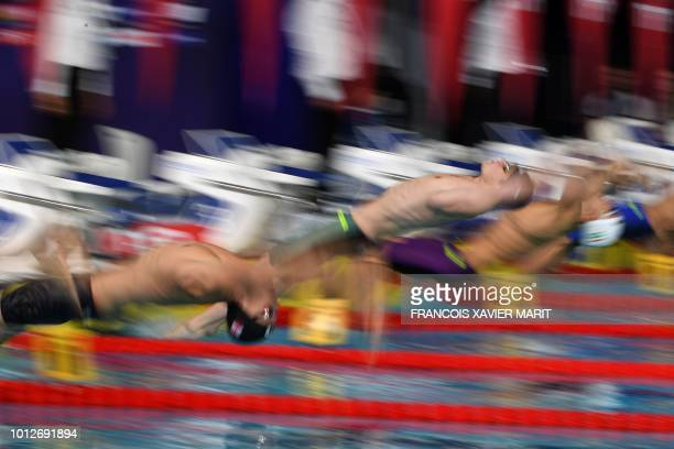 TOPSHOT Competitors start in the Men's 200m backstroke swimming semifinal at the Tollcross swimming centre during the 2018 European Championships in...