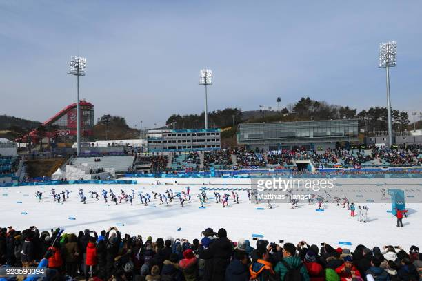 Competitors start the CrossCountry Skiing Men's 50km Mass Start Classic on day 15 of the PyeongChang 2018 Winter Olympic Games at Alpensia...
