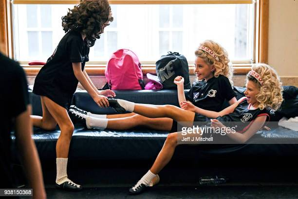 Competitors stretch before taking part in day three of the World Irish Dancing Championships on March 26 2018 in Glasgow Scotland The World Irish...