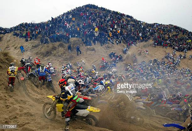 Competitors struggle over the sand dunes in the Enduro race on February 9 2003 in Le Touquet France