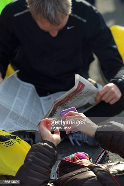 Competitors surfed the Internet and read the paper to pass the time in Athlete's Village before the start of the Boston Marathon Scenes from the...
