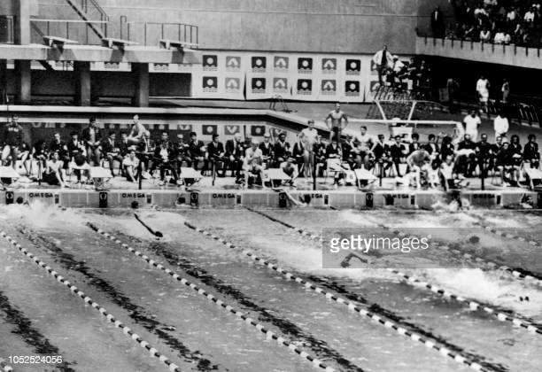 Competitors swim during the men's 4x200m freestyle relay swimming event, won by the US Olympic team , on October 21, 1968 at the olympic...