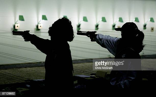 Competitors take aim during the Women's 10m Air Pistol Pairs Final at the Melbourne International Shooting Club during day four of the Melbourne 2006...