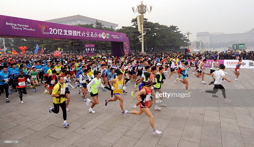 Competitors take off at the start of the Beijing Marathon in the Chinese capital on November 25, 2012. A total of 30,000 runners took part in the race.