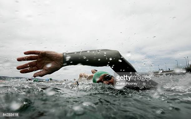 Competitors take off for the start of the swim during the Lorne Pier To Pub open water swim at Louttit Bay January 10 2009 in Lorne Australia The...