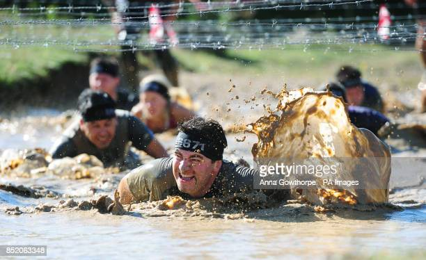 Competitors take part alongside Lance Bombardier James Simpson in the Spartan Race in Ripon North Yorkshire