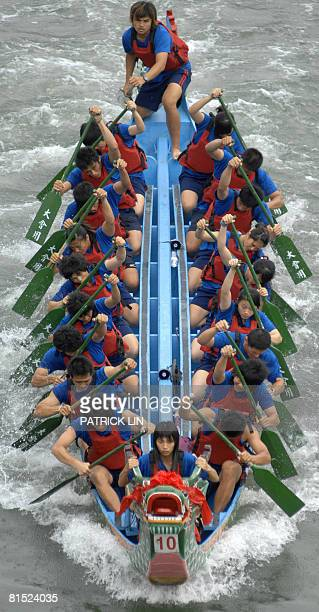 Competitors take part in a heat at the annual dragon boat racing during the Tuen Ng festival in Taipei on June 8 2008 Tuen Ng or dragon boat festival...