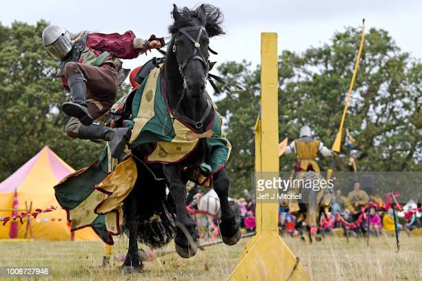 Competitors take part in a jousting competition at Caerlavrock Castle on July 28 2018 in Dumfries Scotland The jousting day is ran by Historic...