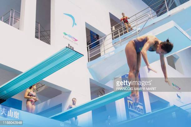Competitors take part in a practice session ahead of the diving event during the 2019 World Championships at Nambu International Aquatics Centre in...