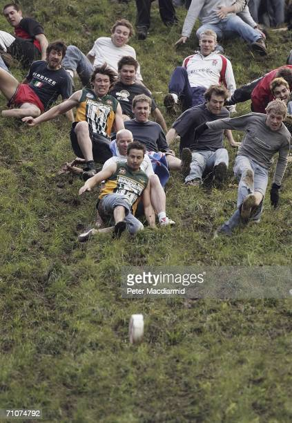 Competitors take part in a round of Cheese Rolling on Coopers Hill on May 29 2006 in Gloucester England The annual tradition which is thought to date...