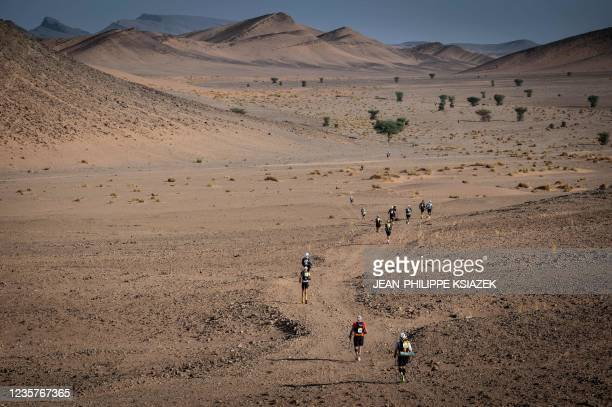 Competitors take part in Stage 5 of the 35th edition of the Marathon des Sables between Boulchrahl and Sud Jebel Irhfelt N'Tissalt in the southern...