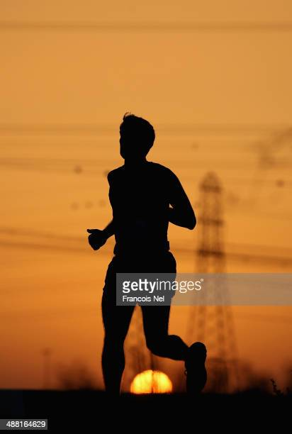 Competitors take part in the 10km Wings for Life World Run at Nad Al Sheba Cycle Park on May 4 2014 in Dubai United Arab Emirates