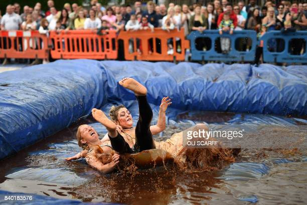 Competitors take part in the 10th annual World Gravy Wrestling Championships held at the Rose 'n' Bowl Pub near Bacup north west England on August 28...