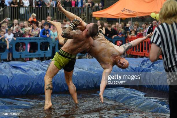 TOPSHOT Competitors take part in the 10th annual World Gravy Wrestling Championships held at the Rose 'n' Bowl Pub near Bacup north west England on...