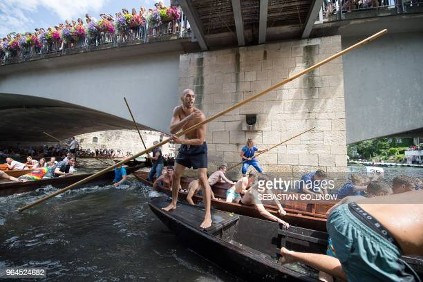 Competitors take part in the 63rd edition of the traditional punt race on the Neckar river in the southern German city of Tuebingen on May 31 2018 /...
