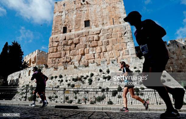 Competitors take part in the 8th International Jerusalem marathon on March 9 2018 / AFP PHOTO / THOMAS COEX