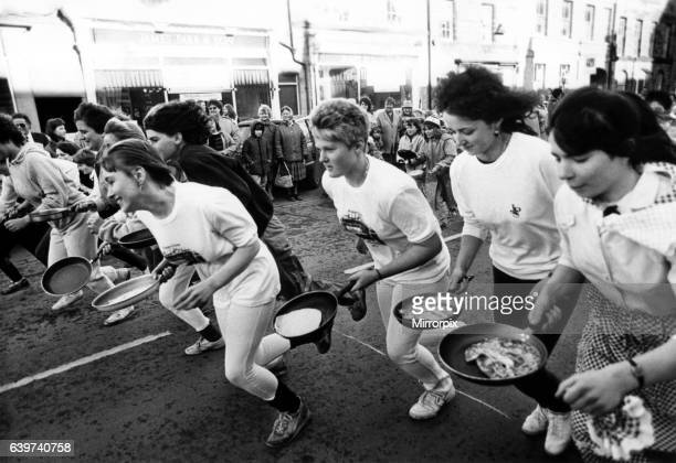 Competitors take part in the Alnwick Shrove Tuesday Pancake race 16 February 1988