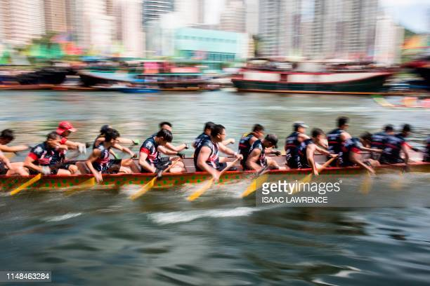 Competitors take part in the annual dragon boat race held to celebrate the Tuen Ng festival in the Aberdeen typhoon shelter in Hong Kong on June 7...